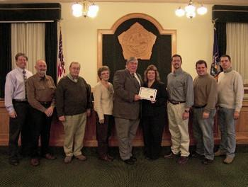 From left, are Oswego County Undersheriff Eugene F. Sullivan III; David Holst, District 4; Committee Vice Chairman Robert Hayes Sr., District 10; Committee Chairwoman Linda Lockwood, District 11; Oswego County Sheriff Reuel A. Todd; Cavalier; Shane Broadwell, District 17; Daniel Farfaglia, District 24; and Shawn Doyle, District 3.