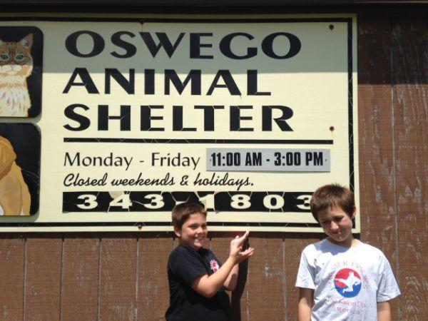 Sage Moody and Zach Kinney from Master Pryor's Taekwondo America in Oswego, visiting the shelter where they will deliver all donations received.